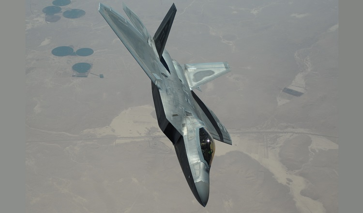 An F-22 Raptor from the 95th Expeditionary Fighter Squadron, Al Dhafra Air Base, United Arab Emirates, flies over Syria March 5, 2018. The F-22, a critical component of the Global Strike Task Force, is designed to project air dominance rapidly and at great distances, and defeat threats attempting to deny access to the Air Force, Army, Navy and Marine Corps. (U.S. Air National Guard photo by Staff Sgt. Colton Elliott)