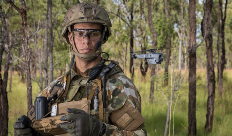 Australian Army soldier Trooper Sam Menzies deploys a PD-100 Black Hornet Nano unmanned aircraft vehicle during training exercise at Shoalwater Bay Training Area, Queensland, on 4 May 2018. *** Local Caption *** Australian Army soldiers from 2nd/14th Light Horse Regiment (Queensland Mounted Infantry) demonstrated the PD-100 Black Hornet Nano unmanned aircraft vehicle during a training exercise at Shoalwater Bay Training Area, Queensland, on 4 May 2018. The Australian Army Headquarters (AHQ) Unmanned Aerial Systems (UAS) Sub Program, in conjunction with the 7th Combat Brigade (7 BDE) are supporting the initial issue of the Black Hornet Nano UAS across an Australian Army Brigade. The Australian Army is the biggest user of Nano UAS in the world and is also the first Army to purchase and issue this technology to conventional forces down to Platoon level, the upcoming completion of the Nano UAS Black Hornet rollout to 7 BDE is a noteworthy achievement and key capability milestone. The Nano UAS Black Hornet roll out to 7 BDE aligns with the Chief of Army's modernisation efforts, and provides a highly visual opportunity to showcase UAS and 7 BDE personnel, equipment and UAS training methodology to key stakeholders.