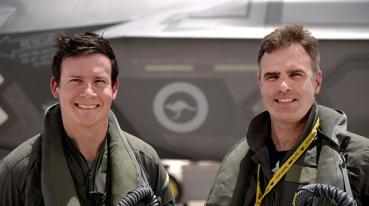 Wing Commander Darren Clare (right), Commanding Officer of No.3 Squadron, pauses to mark the moment when the Australian F-35As completed their first 1000 sorties. He stands with Squadron Leader David Bell, who flew the 1000th sortie in aircraft AU 2.  *** Local Caption *** RAAF personnel at Luke Air Force Base, Arizona, reach a flying milestone as the Australian F-35As complete their first 1000 sorties. The RAAF F-35A team are working together with the 56th Fighter Wing USAF and Lockheed Martin to develop Australia's initial F-35A capability. Royal Australian Air Force pilots and maintenance personnel are fully embedded and integrated in USAF squadrons as they prepare to lead Australia's transition to a fifth-generation Air Force.