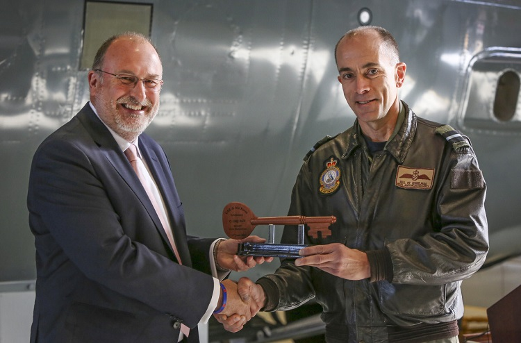 Ian Bell (left) from CAE Australia, presents Commander Air Mobility Group, Air Commodore William Kourelakos, with a key during the C-130J Hercules Fuselage Trainer hand over held at RAAF Base Richmond. *** Local Caption *** On 15 June 2018, a C-130J Hercules Fuselage Trainer was formally handed over at RAAF Base Richmond, providing the first accurate and dedicated cargo compartment training device for any RAAF C-130 variant since the Hercules' introduction in December 2018. The device will be supported by CAE Australia and was constructed by Airbus Australia Pacific, with further assistance from Lockheed Martin, using the fuselages of two retired C-130H Hercules. The Fuselage Trainer will provide a dedicated training environment for Loadmasters as well as other personnel who utilise the C-130J, including Air Dispatchers, Air Movements personnel, and Aero Medical Evacuation specialists. Previously, personnel utilised retired C-130E Fuselage Hulks for training or worked on real C-130J airframes.