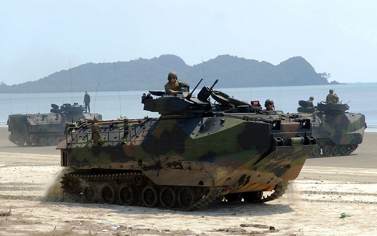 090629-N-5207L-232 RESANG, Malaysia (June 29, 2009) Amphibious assault vehicles transport U.S. Marines and Malaysian Army soldiers from the 9th Royal Malay Regiment along Resang Beach during a Cooperation Afloat Readiness and Training (CARAT) Malaysia 2009 joint amphibious landing exercise. CARAT is a series of bilateral exercises held annually in Southeast Asia to strengthen relationships and enhance the operational readiness of the participating forces. (U.S. Navy photo by Mass Communication Specialist 1st Class Bill Larned/Released)