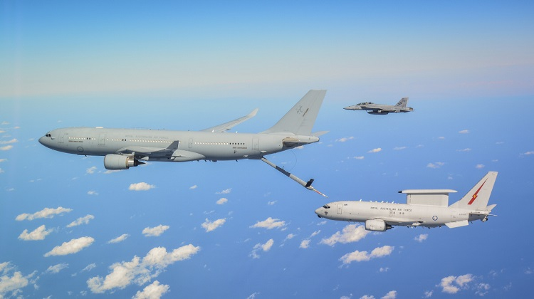 An RAAF KC-30A Multi Role Tanker Transport, E-7A Wedgetail and an F/A-18F Super Hornet fly in formation as they transit to the battlespace on Operation OKRA. *** Local Caption *** The Air Task Group (ATG) is deployed on Operation OKRA and is operating at the request of the Iraqi Government with a US-led Global Coalition assembled to disrupt and degrade Daesh operations in the Middle East Region (MER). The ATG comprises six RAAF F/A-18F Super Hornet fighter aircraft, an E-7A Wedgetail airborne command and control aircraft, and a KC-30A Multi-Role Tanker Transport aircraft. Additionally, the ATG has personnel working in the Combined Air and Space Operations Centre, and embedded with the 'Kingpin' US tactical command and control unit. The ATG is directly supported by elements of Operation ACCORDION including the Theatre Communications Group, Air Mobility Task Group, and the Expeditionary Airbase Operations Unit. There are up to 300 Australian Defence Force personnel deployed, at any one time, as part of, or in direct support of the ATG.